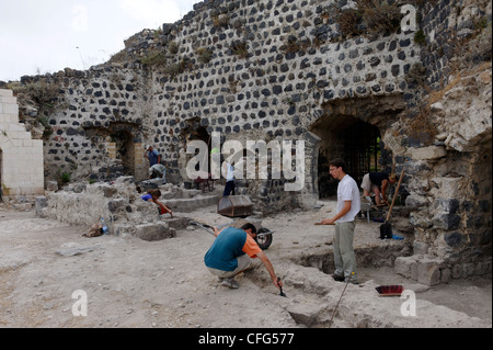 Qalaat Marqab. Syria. View of archaeologists excavating and restoring and section of the crusader castle. Qalaat - Stock Photo