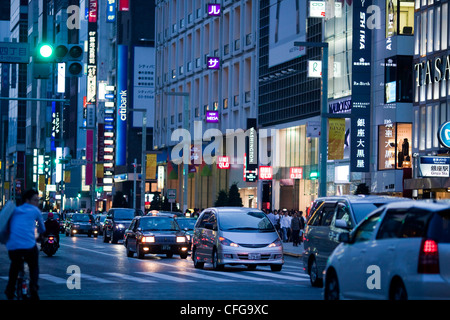 Street traffic and neon lights at night in the Ginza district of Tokyo,Japan - Stock Photo