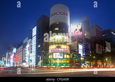 Ginza business and shopping district at night, Tokyo - Stock Photo