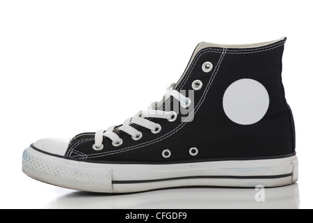One black retro high top sneaker on a white background - Stock Photo
