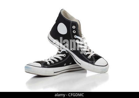 A pair of retro high top sneakers on a white background - Stock Photo