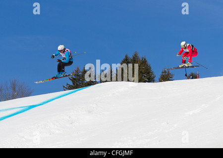 Athletes fight for lead position at FIS Skicross Worldcup March 10, 2012 in Grindelwald, Switzerland. Racer Nick - Stock Photo