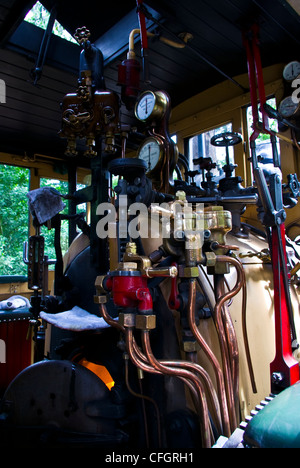 The boiler room and calliper breaks on a restored antique steam train. - Stock Photo