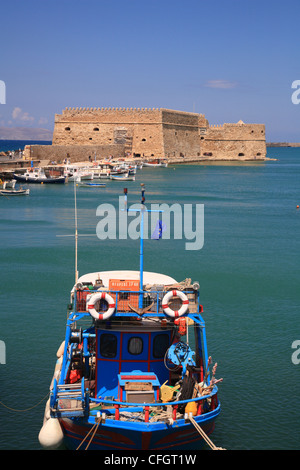 Boat in front of Rocco al Mare, Venetian Fortress, Old Harbour, Iraklion, Crete, Cyclades, Greece - Stock Photo