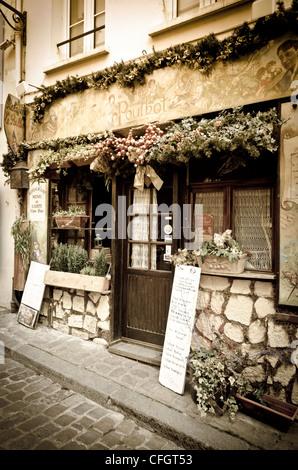 Restaurant Le Poulbot in Montmartre, Paris, France - Stock Photo