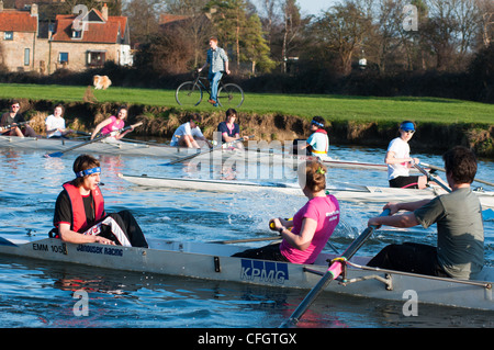 Rowers with cox on the river Cam at village of Fen Ditton near Cambridge, England. - Stock Photo