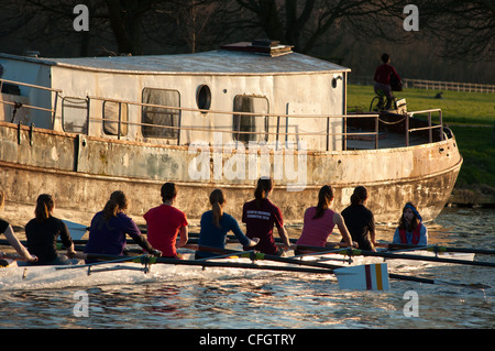 Rowers at sunset on river Cam near Cambridge, England. - Stock Photo