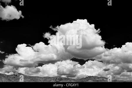 Altocumulus undulatus and cumulus clouds. Cloud sky panoramic. India. Monochrome - Stock Photo