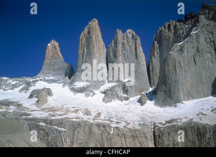 The Granite towers of Torres del Paine National Park, with the remains of the receding glacier at their base - Stock Photo