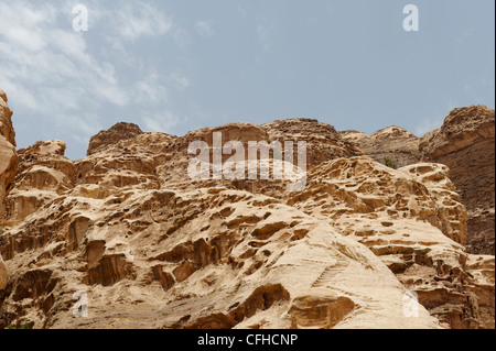 Petra. Jordan. View of the spectacular contorted rock formations found along the winding path up to the Monastery. - Stock Photo