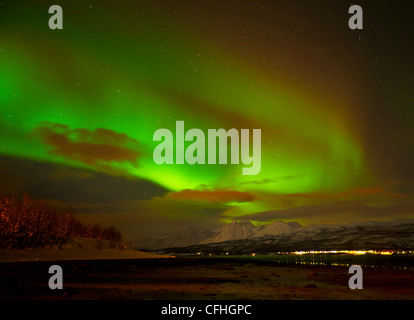 Aurora borealis or northern lights seen over the Lyngen Alps and Ullsfjord, Troms, North Norway, Europe - Stock Photo