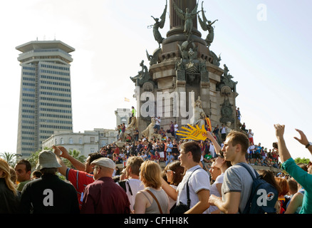 Barcelona FC football fans wait for the team to parade the European cup at the Columbus Monument in May 2011. - Stock Photo