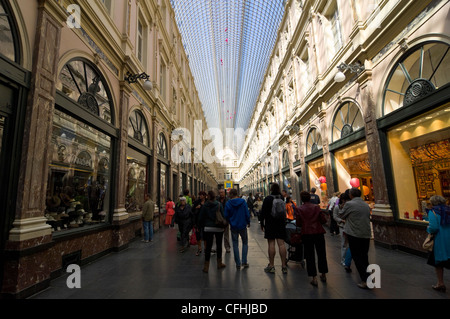 Horizontal view along Galerie de la Reine, part of the Galleries Royales St Hubert, a covered shopping arcade in - Stock Photo