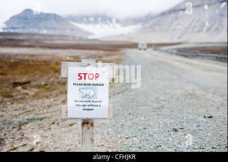 A sign warning about Polar Bears in NY Alesund, Spitzbergen. - Stock Photo