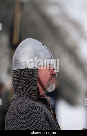 Viking re-enactor wearing chain mail. a helmet and carrying sword at the 27th Annual JORVIK Festival in York, UK - Stock Photo