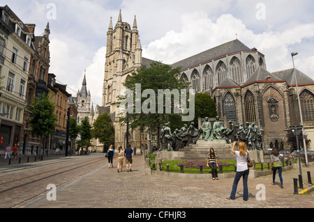 Horizontal view of tourists taking photographs outside St Saint Bavo's Cathedral Church in central Ghent, Belgium - Stock Photo