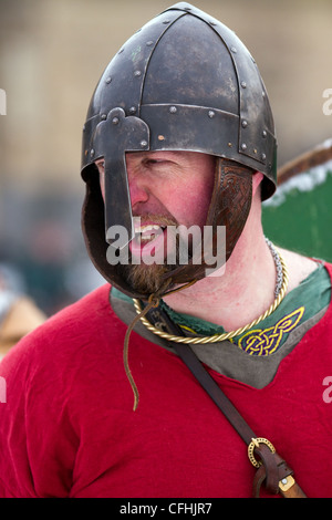 Viking re-enactor wearing Helmet and carrying sword at the 27th Annual JORVIK Festival in York, UK - Stock Photo