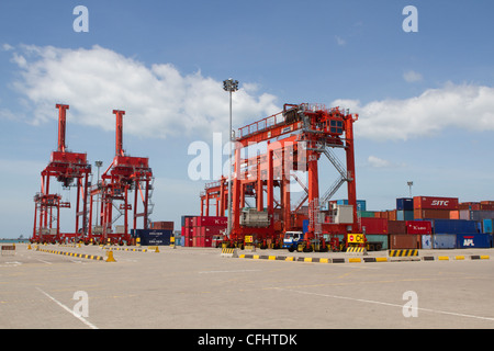 Big container cranes in the port of Sihanoukville, Cambodia - Stock Photo
