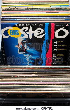 Box of secondhand LP records, Elvis Costello album Best of, England - Stock Photo