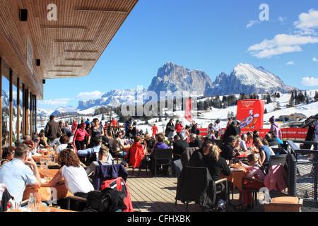 Bar Restaurant Nordic Ski Center, Seiser Alm / Alpe di Siusi, South Tyrol, Italy. View to Langkofel and Plattkofel. - Stock Photo