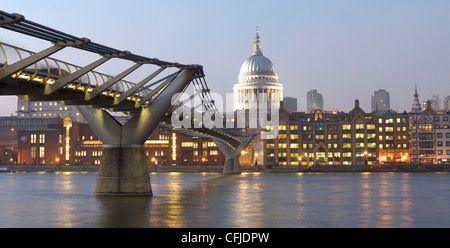 View of the Millennium Bridge over the River Thames in London with St Paul's Cathedral in the background - Stock Photo