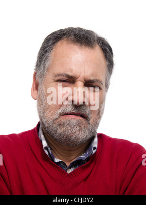 Portrait of a disgusted middle aged bearded man grimacing - Stock Photo