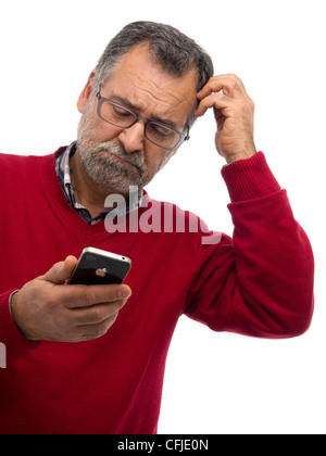Confused mature man using iPhone - Stock Photo