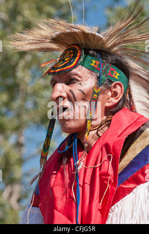 Elder in traditional regalia, Stony Nakoda First Nations, Bar U Ranch, Alberta, Canada - Stock Photo
