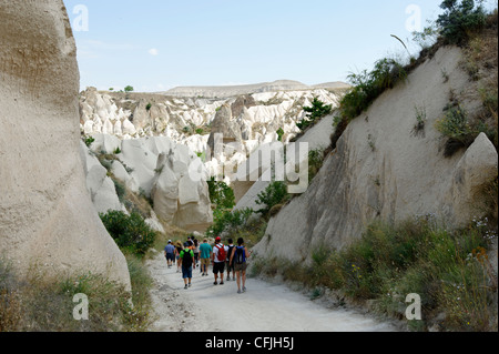 Cappadocia. Turkey. View of tourists hiking along the Rose valley positioned between Goreme and Cavusin villages - Stock Photo