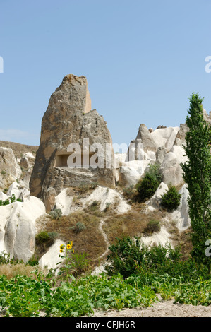Cappadocia. Turkey. View of carved conical shaped volcanic rock tuff along the Rose valley situated between Goreme - Stock Photo