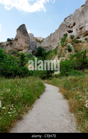 Cappadocia. Turkey. View along the Rose valley pathway with dovecotes hollowed into the volcanic rock tuff in the - Stock Photo