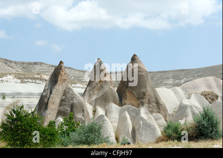 Cappadocia. Turkey. View of conical shaped fairy chimneys and the volcanic rock tuff along the Rose valley in Cappadocia. - Stock Photo