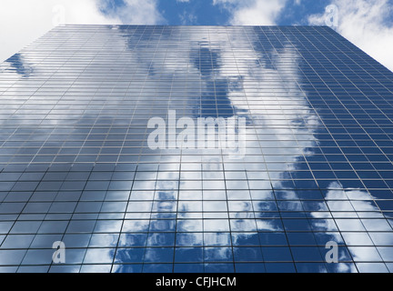 Sky reflected in glass skyscraper - Stock Photo