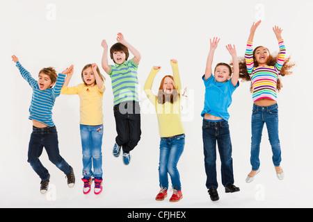 Children jumping - Stock Photo