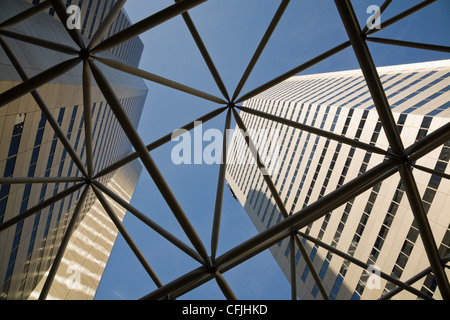 Looking up through steel structure to skyscrapers - Stock Photo