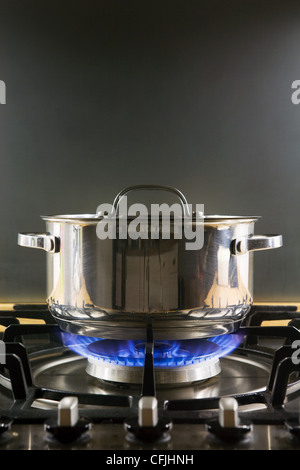 Pan on a gas hob - Stock Photo