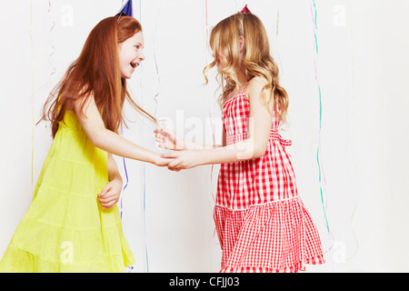 Girls dancing at party - Stock Photo