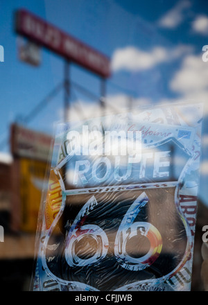 Route 66 sign and street reflection in a shop window on a sunny day in the town of Williams, Arizona, USA - Stock Photo