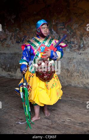 Buddhist monk in colourful costume, Jakar, Bumthang, Bhutan, Asia - Stock Photo