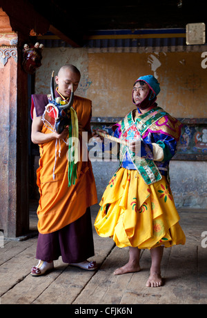 Buddhist monk in colourful costume, Jakar, Bumthang, Bhutan, Asia - Stock Photo