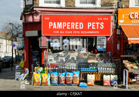 Pampered Pets, pet shop in Holloway Road with bags of food and baskets on the pavement Islington London England - Stock Photo