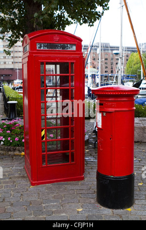 Red telephone and post box at St Katharine's Dock in East London - Stock Photo