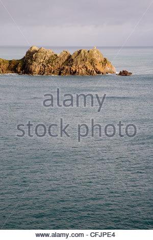 logan rock at the headland near porthcurno cornwall - Stock Photo