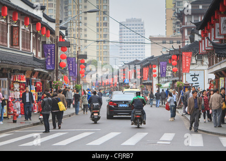 Pedestrians and traffic on Shanghai Old Street, remnant of a bygone age, Fuxing, Shanghai, China, Asia - Stock Photo