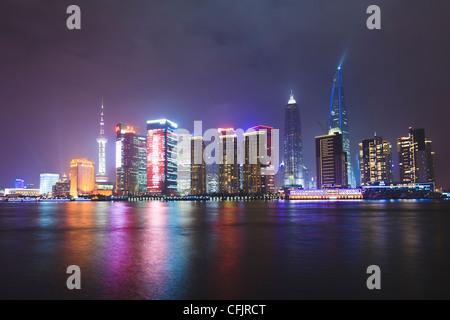 Pudong skyline at night across the Huangpu River, Shanghai, China, Asia - Stock Photo
