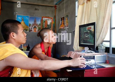 Monks in their dormitory at Wat Moha Montry, Phnom Penh, Cambodia, Indochina, Southeast Asia, Asia - Stock Photo