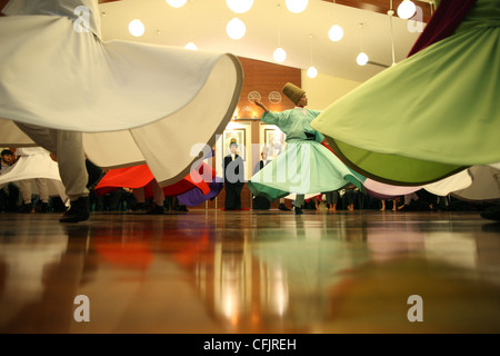 Whirling dervish performance in Silvrikapi Meylana cultural center, Istanbul, Turkey, Europe - Stock Photo