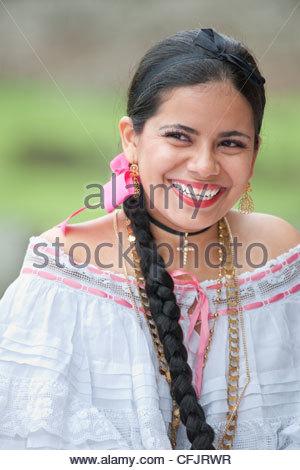 Smiling Panamanian woman wearing a pollera, Panama's national costume, Panama City, Panama, Central America - Stock Photo