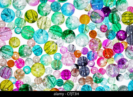 High Key Image of Colourful Glass Jewellery Making Beads on a White Background - Stock Photo