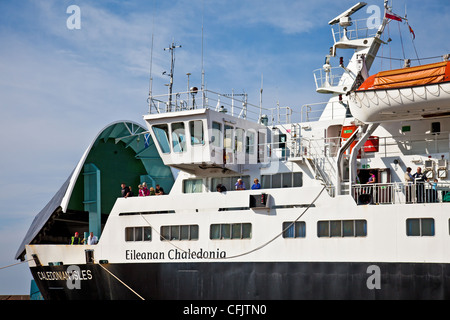 Passengers on board the Cal-Mac Arran ferry Caledonian Isles (Gaelic 'Eileanan Chaledonia') at Ardrossan. The bow - Stock Photo